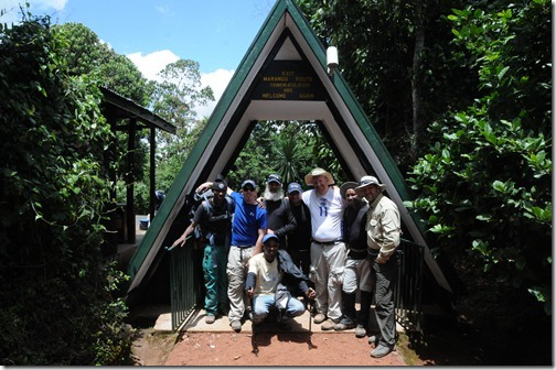 STP Africa team and guides Dawdi and Gabriel at Marangu Gate after a successful summit attempt of Mount Kilimanjaro