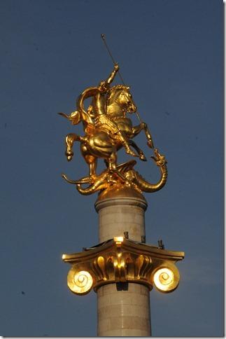 Freedom Monument (თავისუფლების მონუმენტი,) depicting St. George slaying the dragon, in Freedom Square (თავისუფლების მოედანი,) Tbilisi, Georgia