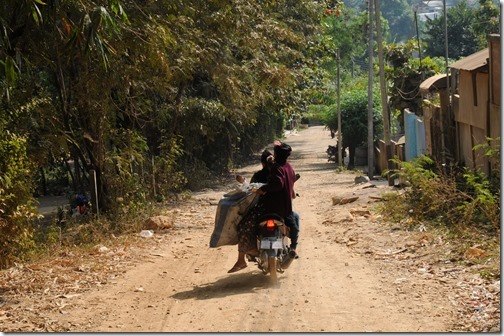Women on a scooter in Tachileik, Burma (Myanmar)