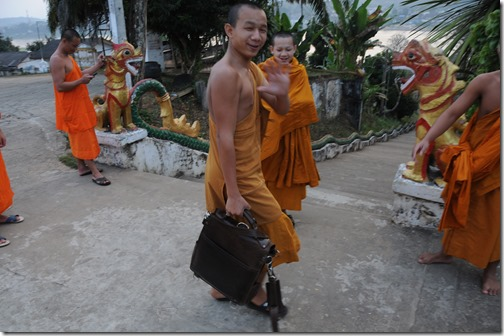 Teenage Buddhist monks taking my Saddleback Leather Messenger Bag for a test run in Ban Houayxay (Huay Xai), Laos
