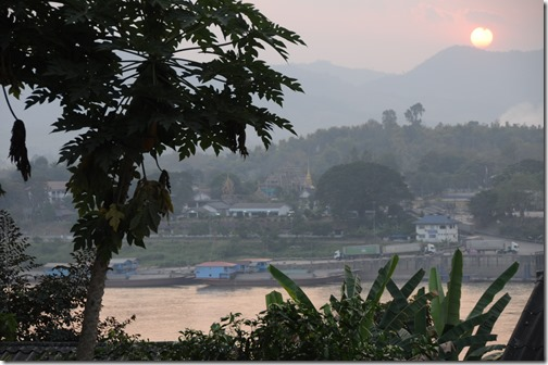 Sunset over Thailand, looking across the Mekong River from Laos