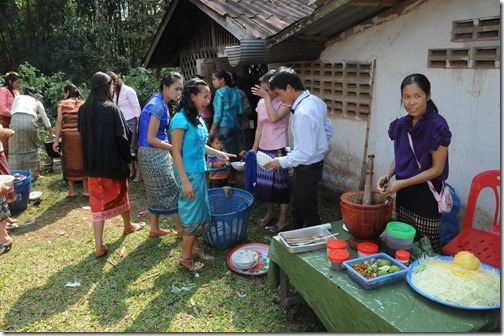 Hard working caterers at a Laotian Wedding in Ban Houayxay (Huay Xai), Laos