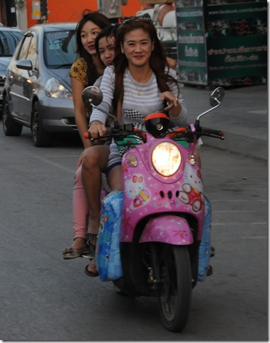 Local girls riding on a 'Hello Kitty' scooter in Chiang Rai District, Thailand