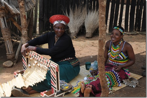 Actresses making traditional clothing inside Shakaland, South Africa