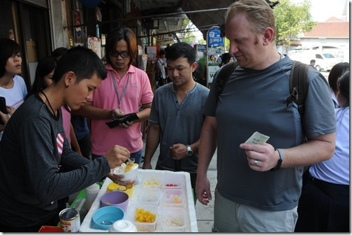 My friend Joel Oleson sampling some of the street food in Bangkok, Thailand