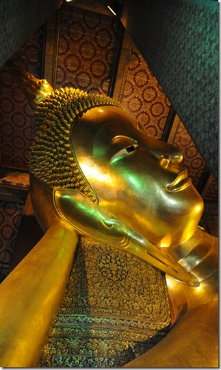 Head of the Reclining Buddha at Wat Pho, Bangkok, Thailand